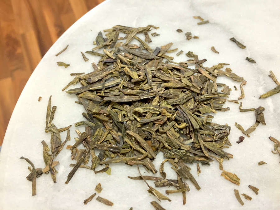 Dragonwell (TeaVana): loose leaf by Jocilyn Mors is licensed under a Creative Commons Attribution-ShareAlike 4.0 International License.
