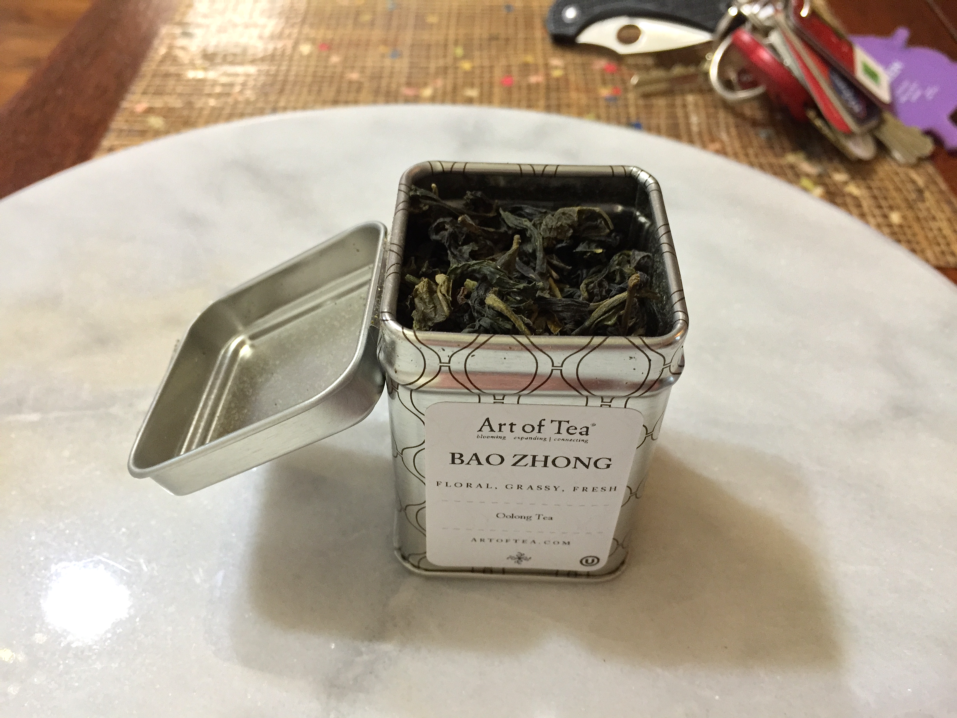 Bao Zhong High Grade (Art of Tea): canister open by Jocilyn Mors is licensed under a Creative Commons Attribution-ShareAlike 4.0 International License.