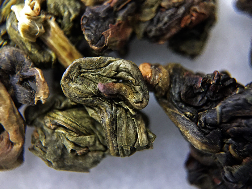Formosa Jade Oolong (Upton) - loose leaf macro by Jocilyn Mors is licensed under a Creative Commons Attribution-ShareAlike 4.0 International License.