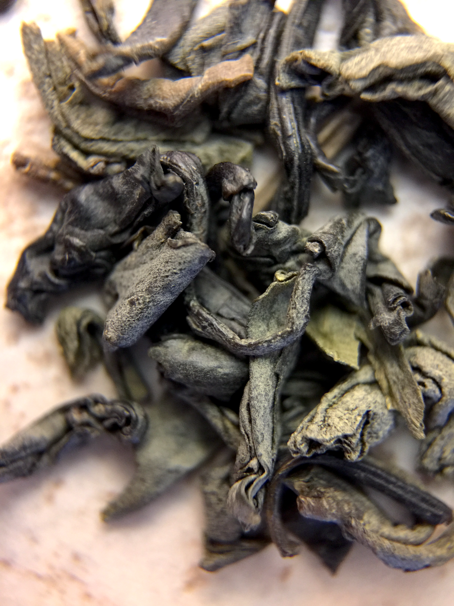 Photograph of Chun Mee (Arbor Teas) ~ loose leaf macro by Jocilyn Mors is licensed under a Creative Commons Attribution-NonCommercial-ShareAlike 4.0 International License.