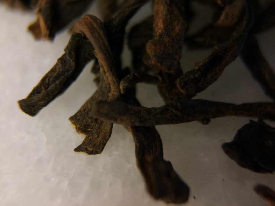 Photograph of China Aged Pu-Erh Celestial Tribute (Upton) ~ loose leaf macro by Jocilyn Mors is licensed under a Creative Commons Attribution-NonCommercial-ShareAlike 4.0 International License.